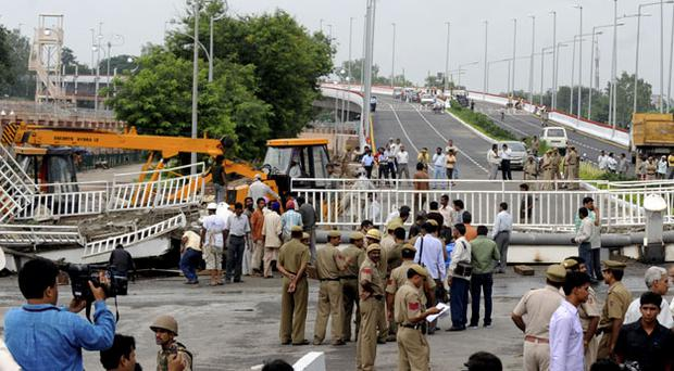 A footbridge at the main stadium collapsed today - adding to the woes of the Games. Photo: Getty Images
