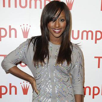 Alexandra Burke has held on to the top spot in the singles charts