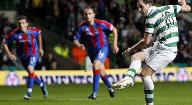 Celtic's Anthony Stokes scores from the penalty spot against Inverness during their CIS Cup match at Parkhead last night - Celtic ran out 6-0 winners. Photo: Reuters