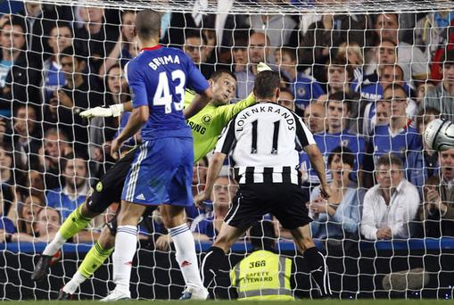 Shola Ameobi (unseen) heads the ball past Chelsea's goalkeeper Ross Turnbull to score the winner for Newcastle last night. Photo: Reuters