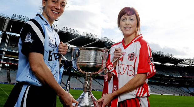 Dublin captain Denise Masterson and Tyrone's Sinead McLaughlin pictured at Croke Park ahead of their Ladies Football Senior final on Sunday. Photo: Brian Lawless / Sportsfile