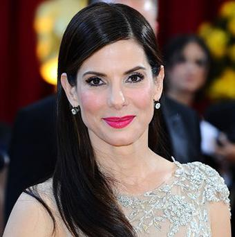 Sandra Bullock has apparently been approached to star in Never Forget