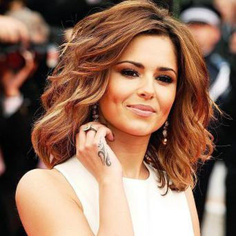 Cheryl Cole isn't comfortable about being labelled a sex symbol
