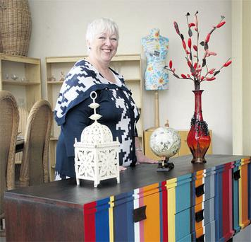 Bernie Walsh, with one of her refurbished bespoke handpainted sideboards at Busy Bees on Bridgefoot Street, Dublin.