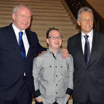Martin McGuinness and Peter Robinson have hailed budding poet Michael O'Donoghue