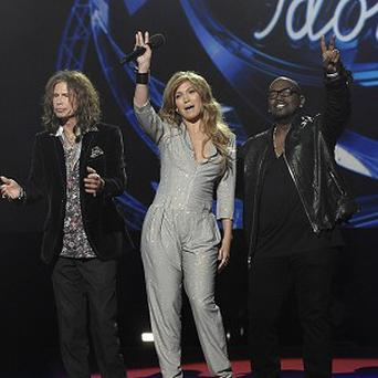From left to right, singer Steven Tyler, singer Jennifer Lopez, and musician Randy Jackson will judge American Idol. (AP)