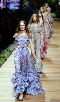 MILAN, ITALY - SEPTEMBER 23: Models walk the runway during the D&G Milan Fashion Week Womenswear S/S 2011 show on September 23, 2010 in Milan, Italy. (Photo by Venturelli/WireImage)