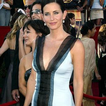 Courteney Cox says she's been reminscing on the set of Scream 4