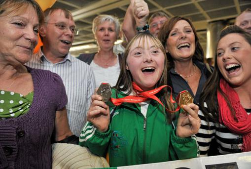 Special Olympic athlete Breffni McCarthy shows off her gold medal for the 100 metres and silver for relay at Dublin Airport yesterday. Photo: Brian Lawless / Sportsfile