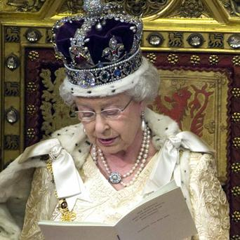 Britain's Queen Elizabeth II reads the queen's speech from the throne in the House of Lords during the opening of parliament in London. Photo: Reuters