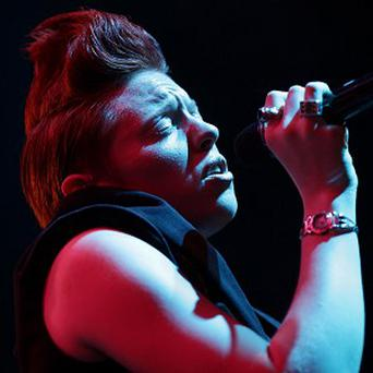 Elly Jackson of La Roux has apologised for how long the band's second album is taking