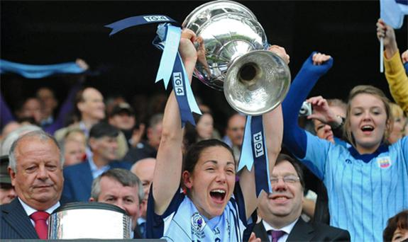 Dublin captain Denise Masterson lifts the Brendan Martin Cup. Photo: Sportsfile
