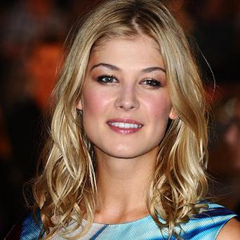 Rosamund Pike says her Johnny English character is nothing like the Bond villain she played