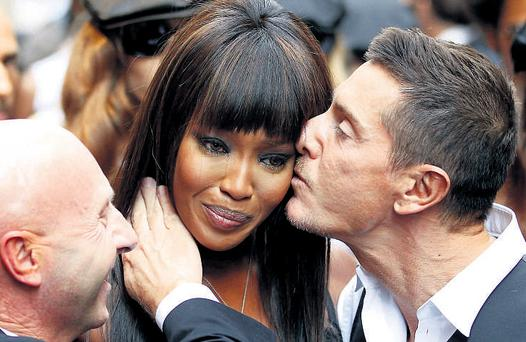 Naomi Campbell cries as she meets Italian designers Domenico Dolce and Stefano Gabbana during a party in her honour in Milan. REUTERS