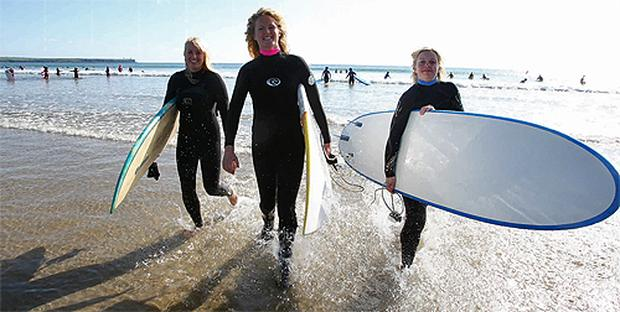 Lorna Walsh, Alana Power and Valerie Brett on Tramore Beach for Ladies Surf Weekend