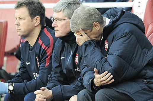 Arsenal manager Arsene Wenger can barely watch as West Brom beat his side 3-2