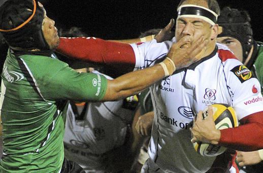 Ulster's BJ Botha attempts to hand-off Connacht's Ray Ofisa during Saturday's Magners League clash at the Sportsground.