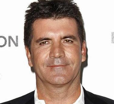 Simon Cowell's biography is the book most often left behind in hotel rooms, a survey shows. Photo: PA