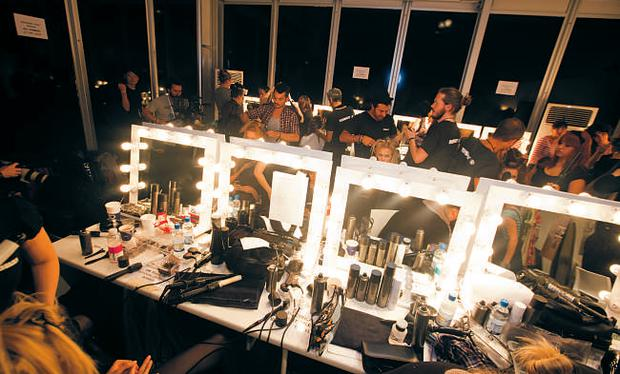 Make-up artists and models vie for space backstage
