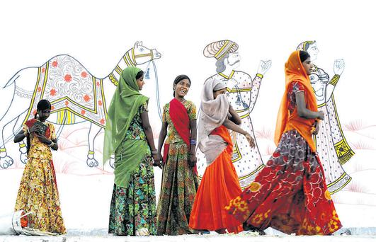 The overall winner of Lonely Planet's photography competiton: five women parading on a performance stage at Pushkar ka Mela