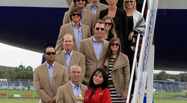 Step one: as the American 'WAGs' joined their partners, Tiger Woods was left alone. Photo: Reuters
