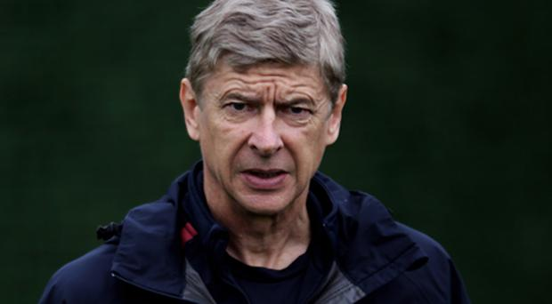 Arsene Wenger during a training session yesterday. Photo: Getty Images