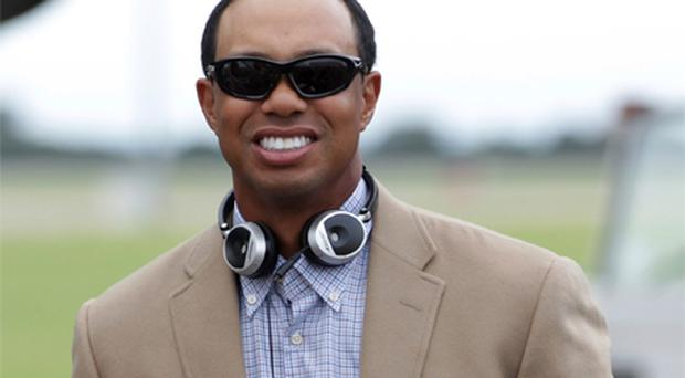 In company with the rest of the American Ryder Cup team, Tiger Woods touched down in Wales yesterday wearing a pair of sunglasses but with little to say