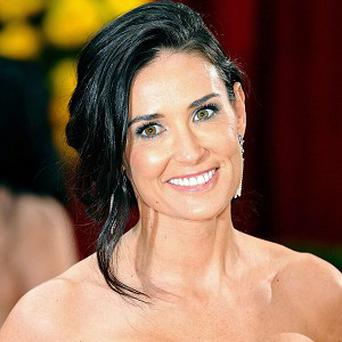 Demi Moore has settled a claim with a magazine over photos it published of a post-Oscars party
