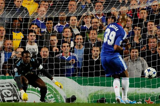 Chelsea's Nicolas Anelka scores a penalty past Marseille's goalkeeper Steve Mandanda during their Champions League match at Stamford Bridge last night