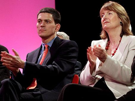 Former British Foreign Secretary David Miliband and Labour deputy leader Harriet Harman listen to Labour Party leader Ed Miliband's keynote speech. Photo: Getty Images