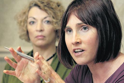 Ann Marie Meenan (left) listens to Dr Janice Walshe, consultant medical oncologist at St Vincent's Hospital, speaking at the Westin Hotel in Dublin yesterday