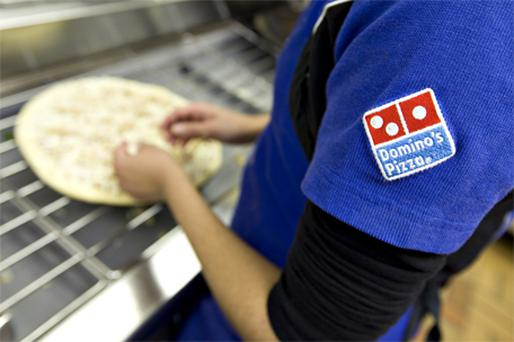 Dominos trade was also aided by the company's new iPhone app. Photo: Bloomberg News