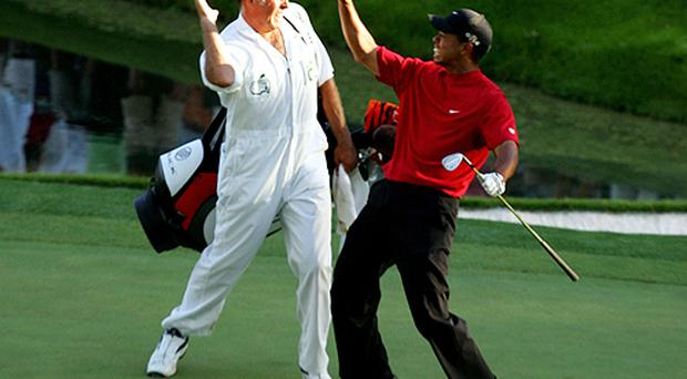 Tiger Woods celebrates his miracle chip in 2005. Photo: Getty Images