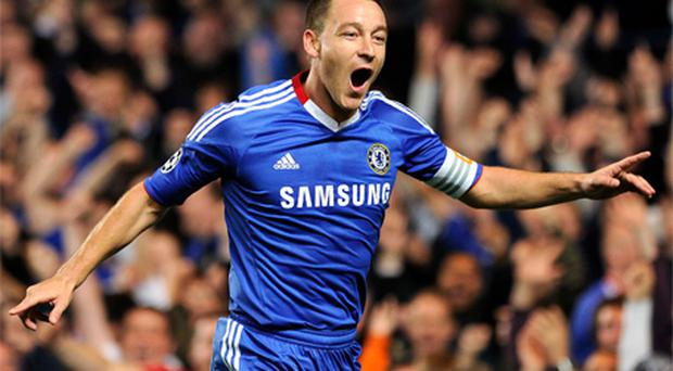 John Terry celebrates after scoring the opening goal on Tuesday night to set Chelsea on their way to victory against Marseille at Stamford Bridge