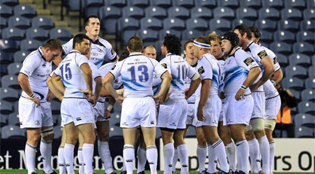 The Leinster team stand in a huddle