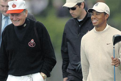 Michael Smurfit playing a round of golf with Tiger Woods during a pro-am at Adare Manor in 2005