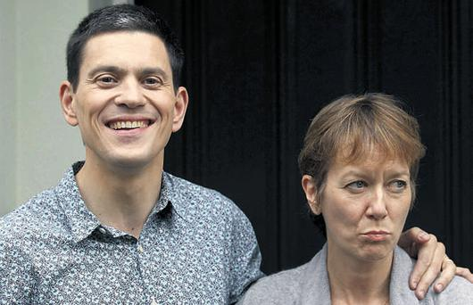 British Labour politician David Miliband with his wife Louis Shackleton outside their home in London yesterday