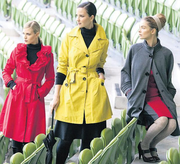 Jude wears a red trench coat and black leggings, Baiba wears a yellow rain mac and jersey skirt, and Nikki models a grey jersey coat and jersey skirt, all from M&S. JAMES HORAN/PETER HOULIHAN