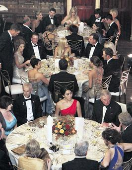 Prince Charles dining with both teams, with Ireland's Padraig Harrington and his wife Caroline at the top of the photograph