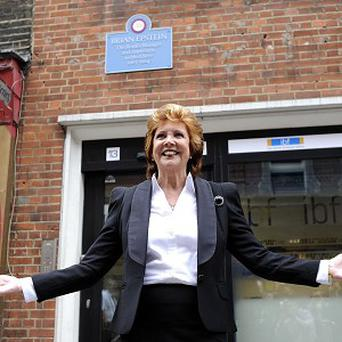Cilla Black unveils a plaque to remember Brian Epstein