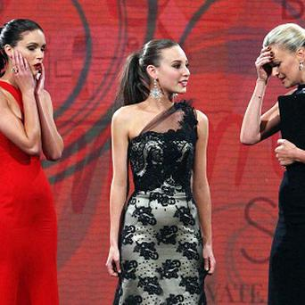 Host Sarah Murdoch reacts after announcing the wrong winner (AP)