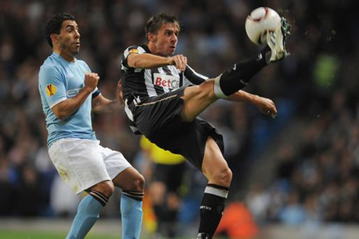 Carlos Tevez of Manchester City in action with Zdenek Grygera of Juventus. Photo: Getty Images