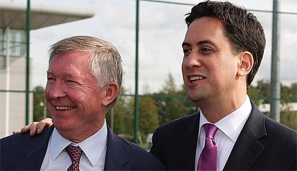 Labour leader Ed Miliband (right) meets Man Utd manager Alex Ferguson at the club's training ground yesterday. Photo: Reuters
