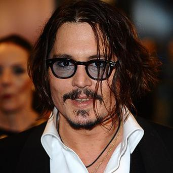 Johnny Depp has reportedly been sailing to work while filming the latest Pirates movie