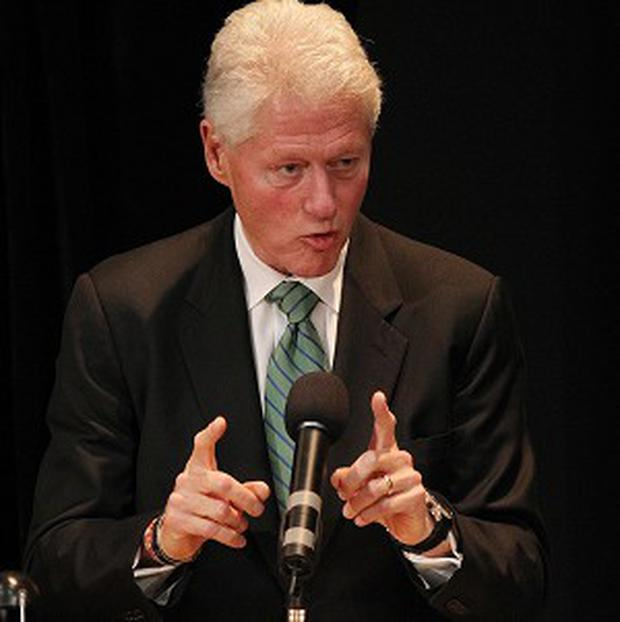 Bill Clinton urged Irish voters to examine which leader can best dig the country out of its economic mess
