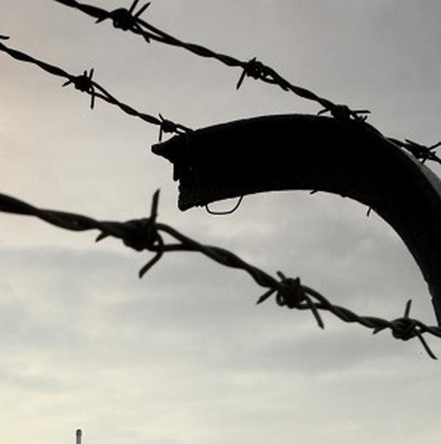 A prisoner's clothes were stripped away by razor wire as he tried to escape a US jail
