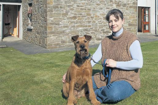Gabriela Briner, pictured with her dog Joya, above, outside Hillview Farm, which is to be sold at auction next week