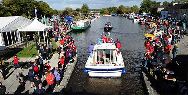 A band plays on a boat as it enters Richmond Harbour, Clondra, Co Longford during celebrations which attracted hundreds of people to the shore