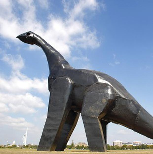 A 16-metre dinosaur recently installed on Southsea Common in Portsmouth has been destroyed by fire