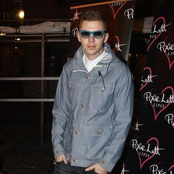 Professor Green said it was hard to keep Lily Allen's pregnancy a secret